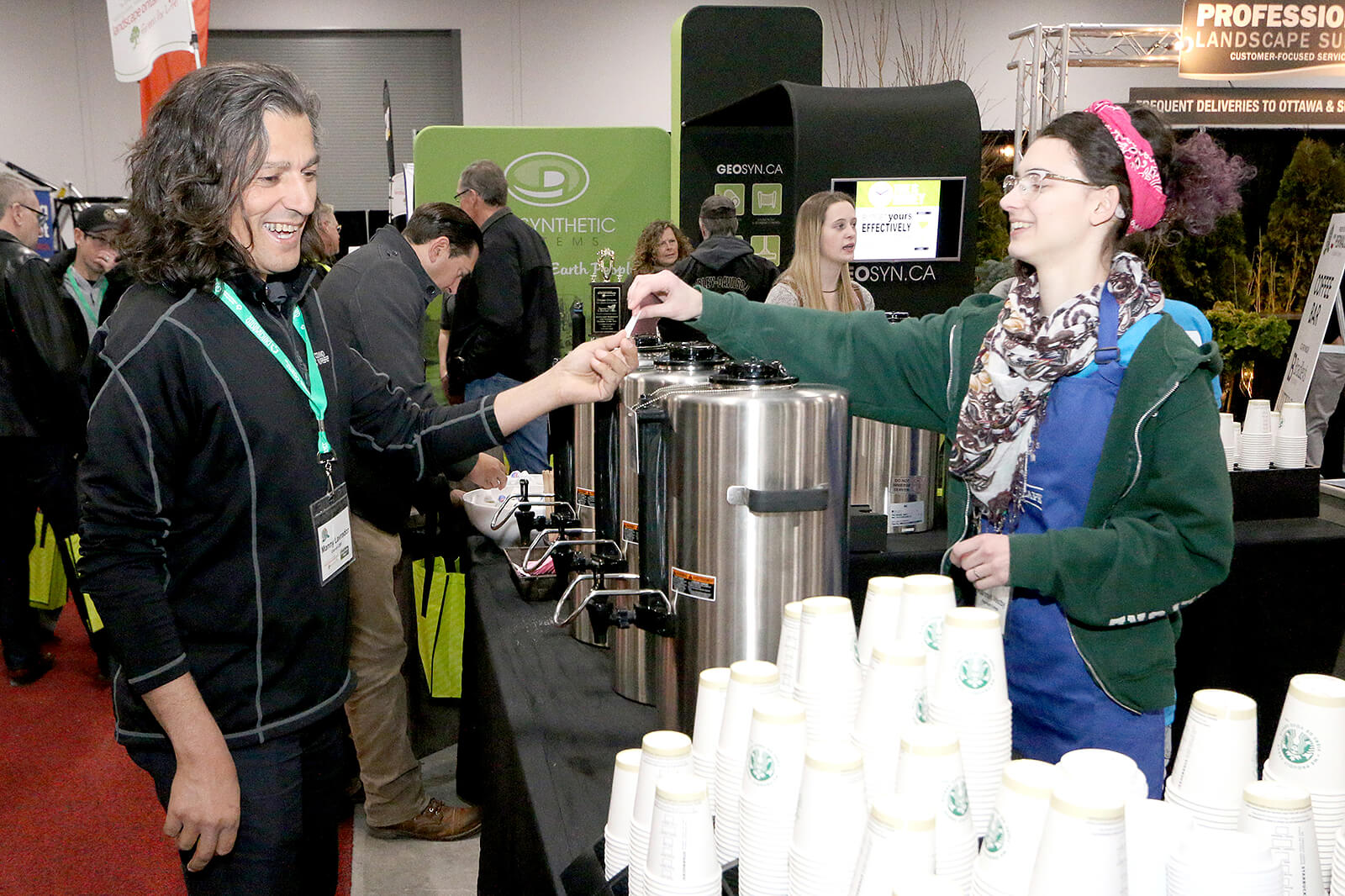Volunteers greet exhibitors and attendees with a smile at the Coffee Bar on the trade show floor.