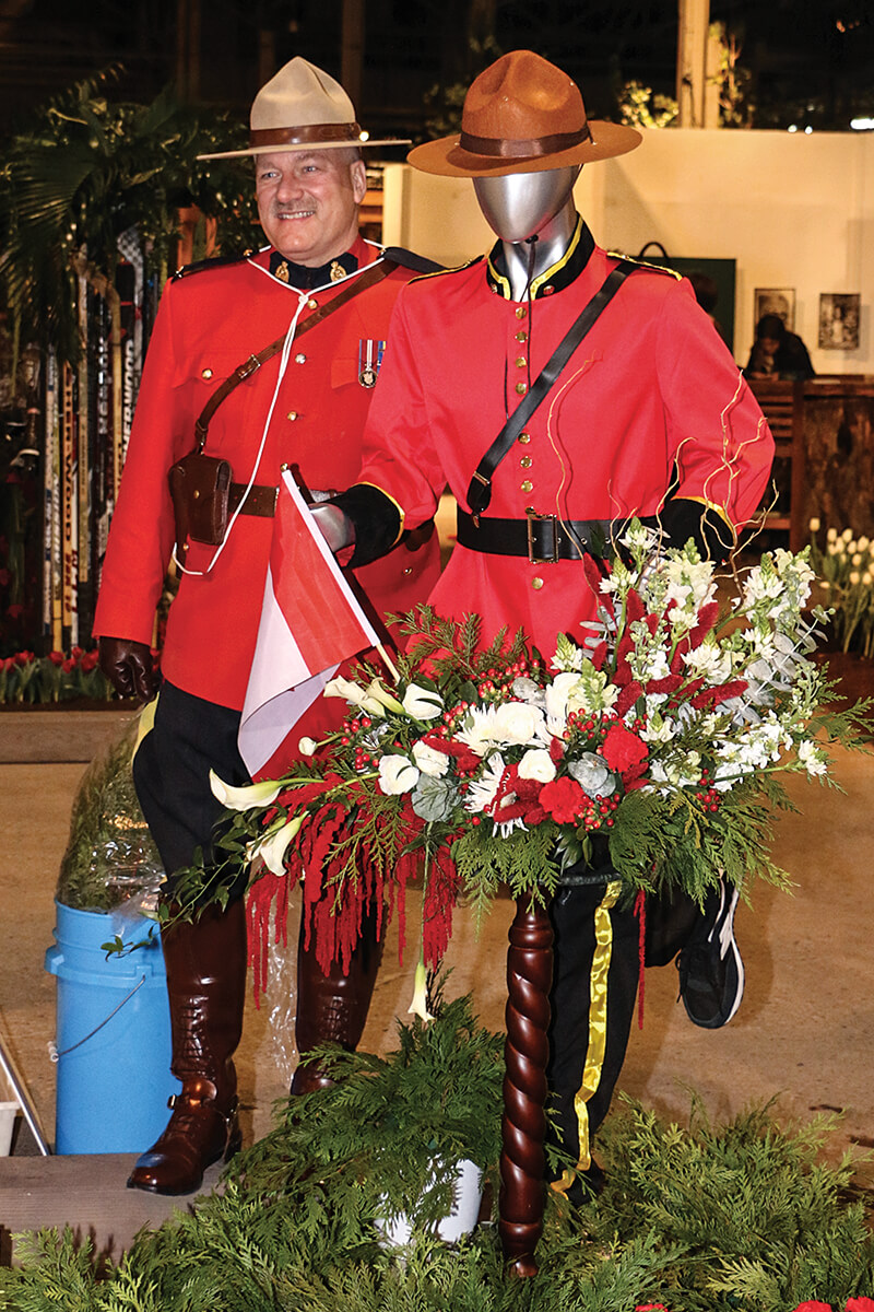 canadian mountie in uniform beside a floral mountie
