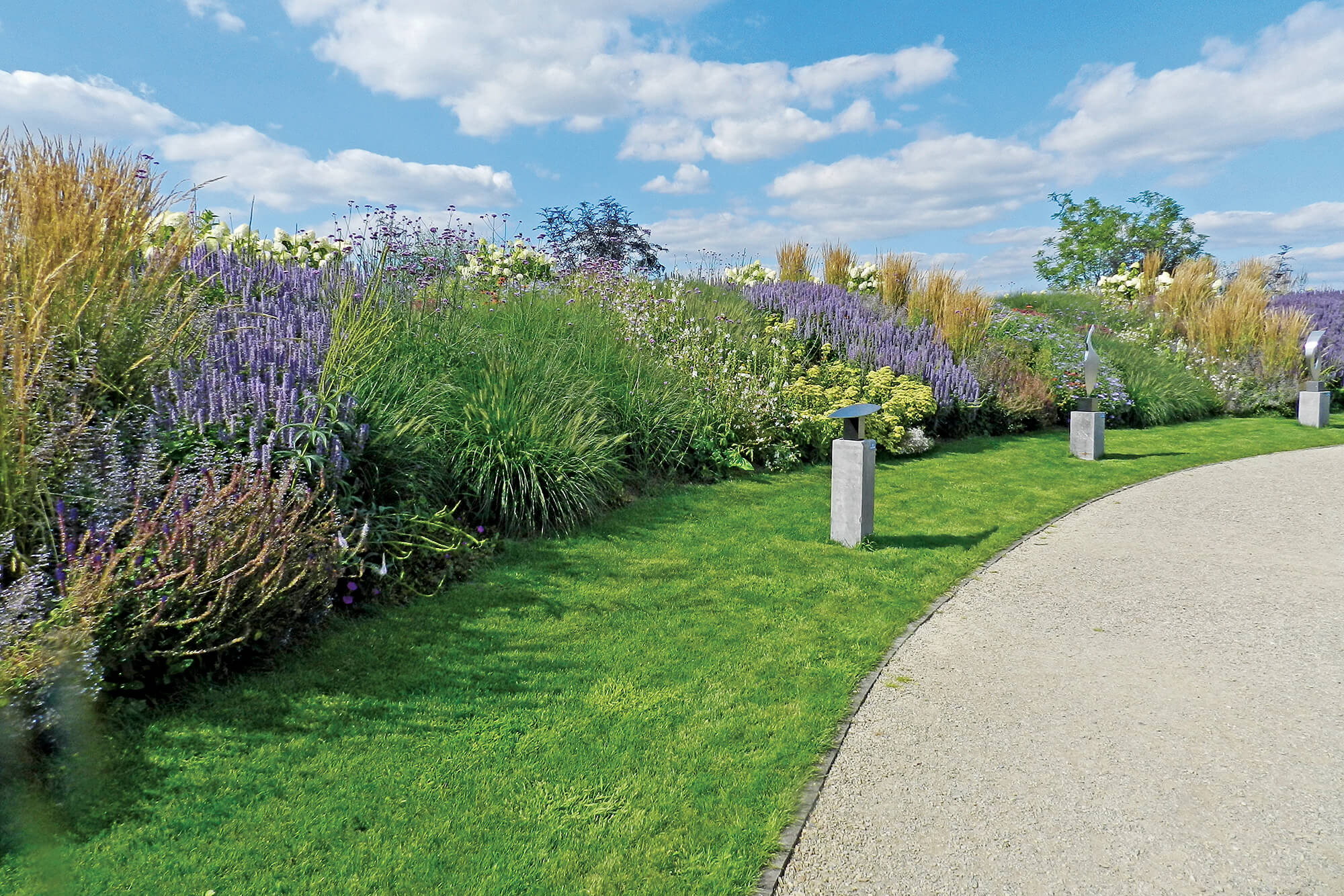 A nice display of various perennials next to a path