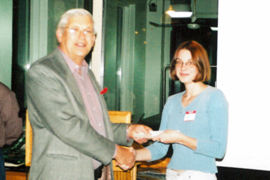 man giving an award to a young lady