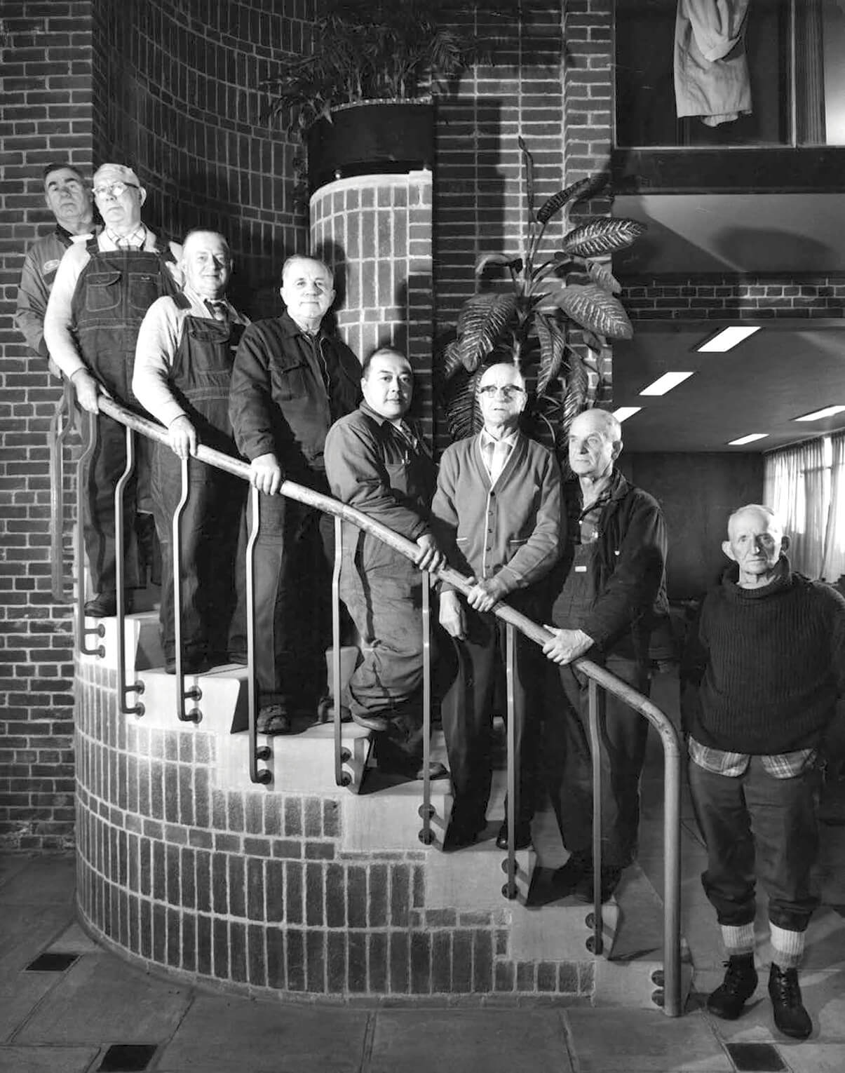 old black and white photo with a group of people on the stairs