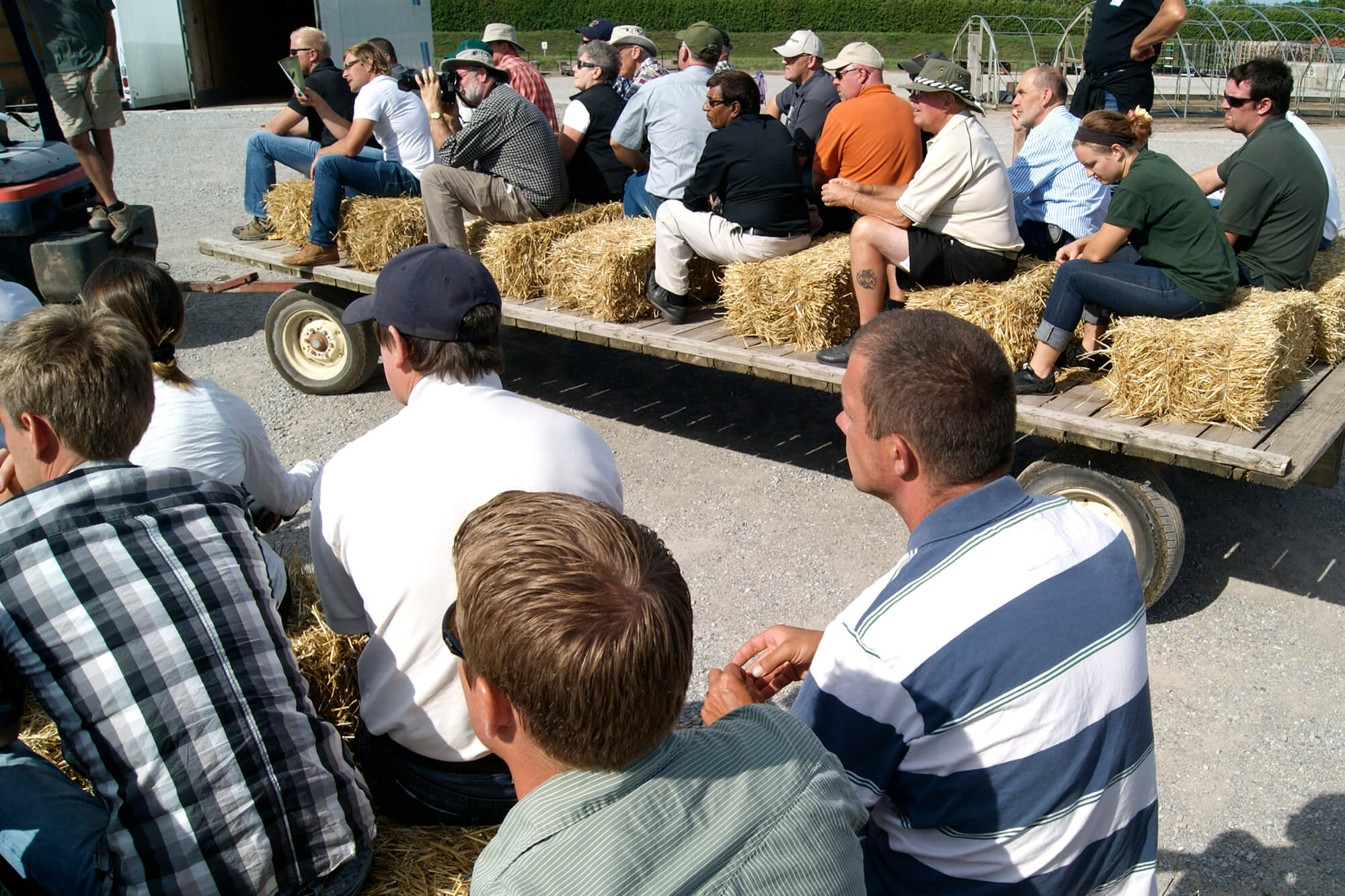 people on a wagon ride tour of a nursery grower