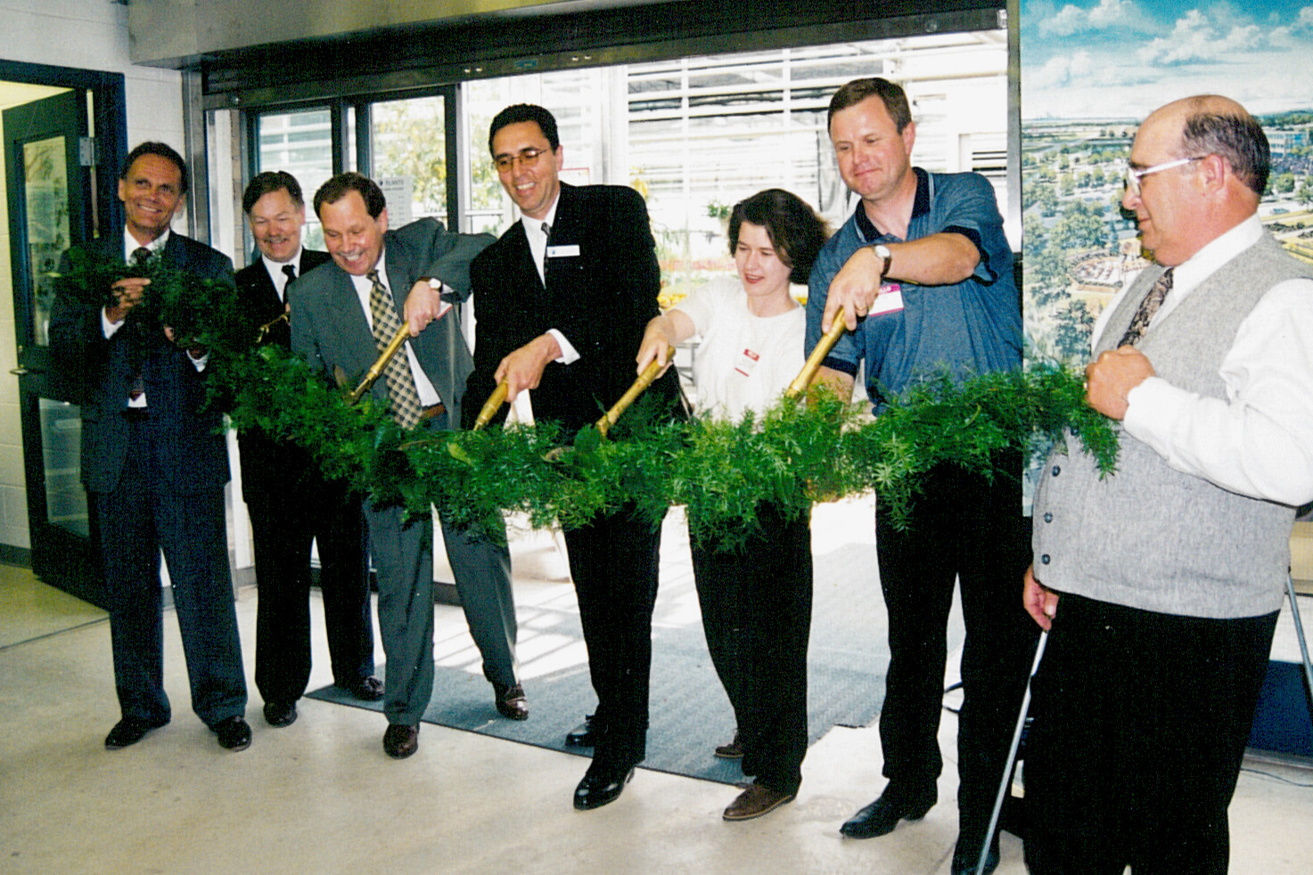 group of people cutting a ribbon