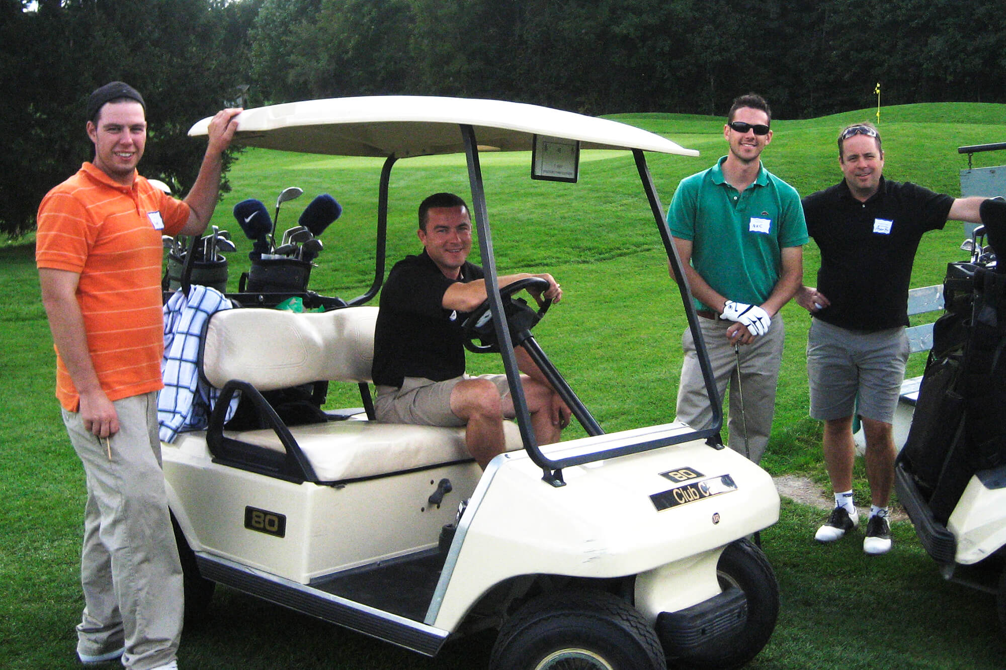 4 men on a golf course