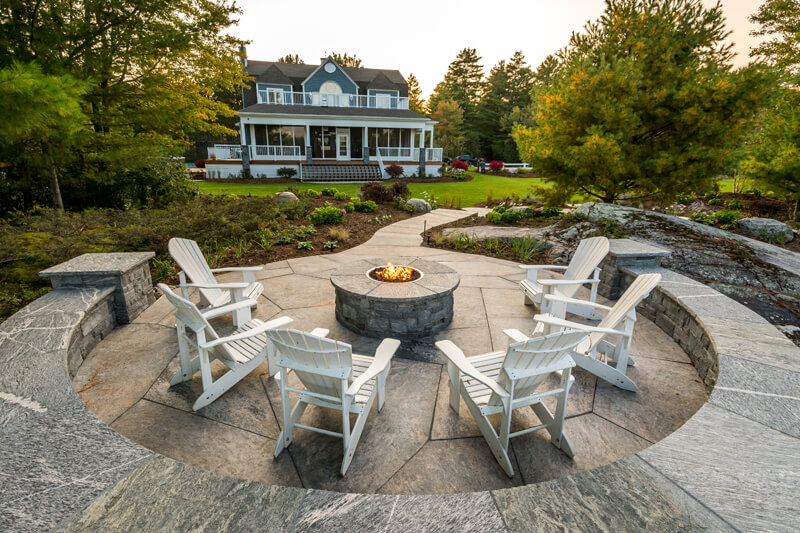 outdoor firepit with chairs around it