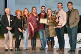 Modern Landscape Designers and Trimatrix Construction receive the Garden of the Year Award on stage at Canada Blooms.