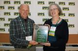 IPPS Eastern Region Past President, Dale Pierson presents the award to Peggy Walsh Craig.