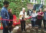 Students accompany Liz Sandals, MPP Guelph at a ribbon cutting ceremony to celebrate the new garden.