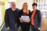 (L-R) Tony DiGiovanni and Cassandra Wiesner from Landscape Ontario accept an award from Deborah Martin-Downs, CAO of Credit Valley Conservation.