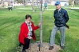 Ann Evers (left) and Windsor Chapter member, Lex Kraft attend a tree dedication ceremony to honour the late Fred Evers in Kingsville, Ont.