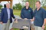 From left, Hanover businessman, Bill Roseborough, who approached Landscape Ontario members Paul Brydges of Brydges Landscape Architecture  and Tim Kraemer of Ground Effects Landscapes, to design, build the structure and landscape the area of the Country Meadow Estates Rest Area in Hanover.