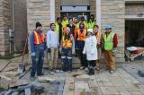 Chris Ray of Humber Valley Landscaping (first in back row), and his team of industry members and students from the Humber College Landscape Technician program and homeowner Cory Allard (in white).