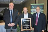 Bill Hardy, chair of the CNLA Public Relations Committee, presents Grant Harrison, London Chapter president, and Barry Sandler, executive director of the Veterans Memorial Parkway Community Program, with the Green for Life Community Award.