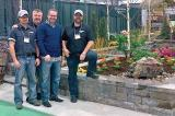 In the photo from left are Mike Reid and Rob Garby, both of Hansen Lawn and Gardens,  Michael Fulcher of Permacon and president of the Ottawa Chapter, Ed Hansen of Hansen Lawn and Gardens as they pose at the LO garden at the Ottawa Cottage and Back Yard Show.