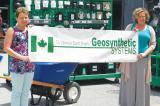 Grout and team stopped in for a delicious barbecue lunch at Geosynthetic Systems with Sue Windover, left, and Kelly Mulrooney-Côté.