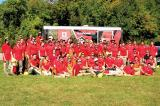 Fanshawe College students, dressed in their distinctive red, offered their services to help guide volunteers to plant over 400 trees along the Veterans Memorial Parkway in London.