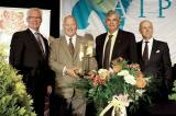 For the second consecutive year, Sheridan Nurseries received the AIPH world grower of the year award. In photo, from left, Vic Krahn, president of AIPH, Karl and Bill Stensson accepting the award on behalf of Sheridan and LO president Phil Charal.