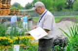 Michael Pascoe of Fanshawe College was kept busy judging plant material at this year's auction.