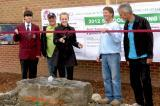 LO members, Jason Dietrich of Ace Lawncare, Thomas Blatter of Dreamestate Landscaping and Don Prosser of Don Prosser Landscape Design help students with the ribbon cutting at St. James Catholic High School garden.
