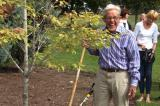 Barry Benjamin, a past president of LO, helps plant a tree at LO home office in Milton to mark National Tree Day.