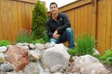 Chris Le Conte of Smart Watering Systems demonstrates harvesting rainwater within attractive landscape.