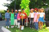 The children from Lancaster Elementary School in Mississauga stand proudly by their new maple tree donated by Landscape Ontario.