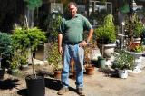 Tony Sgambelluri stands in front of his garden centre in Grimsby.