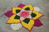 Flower heads and flower petals used to make a rangoli design.
