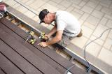 Adam Papple, from Perfectview Decks and Landscaping, works on deck stairs at a job site in Oakville, Ont.