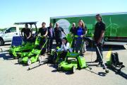 The team from International Landscaping proudly displaying solar and electric grounds maintenance equipment.