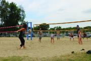Family Day attendees work off their lunch during a pick-up game of volleyball at Bingemans.