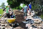 Participants building a pondless waterfall on the LO site in Milton, Ont.