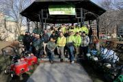 Green industry volunteers assembled at the park's gazebo to go over the maintenance plan before getting to work.
