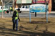 Volunteers began the clean up by raking the turf in the park.