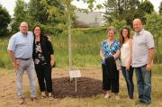 Members of the Olsen family gather around a newly planted Autumn Blaze maple in memory of the late Paul Olsen. (L-R): Jeff, Diane, Linda, Jennifer and Peter Olsen.