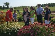 Rodger Tschanz (left), leads a tour of the trial garden site in Guelph.