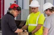 Harry Gelderman (left) works with Mohawk College Apprentices during a pre-build at the college.