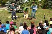Clintar's Terry Nicholson (left) explains the positive effects of trees to a group of students at German Mills Public School in Markham.