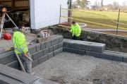 A crew from Bruce Wilson Landscaping rebuilds the loading dock at the LO office in Milton.