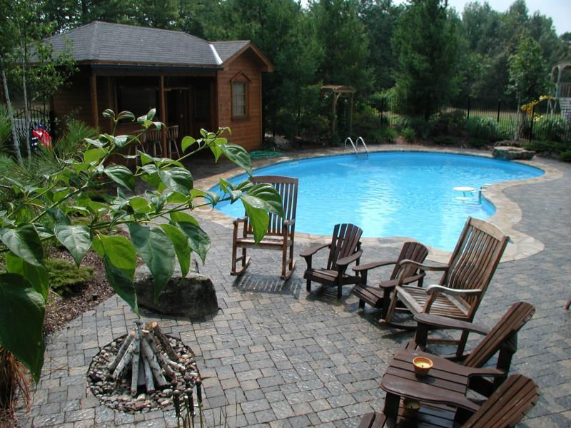 2006 - Residential Construction - $250,000 - $500,000 - Seating for all in the family around the poolside firepit.