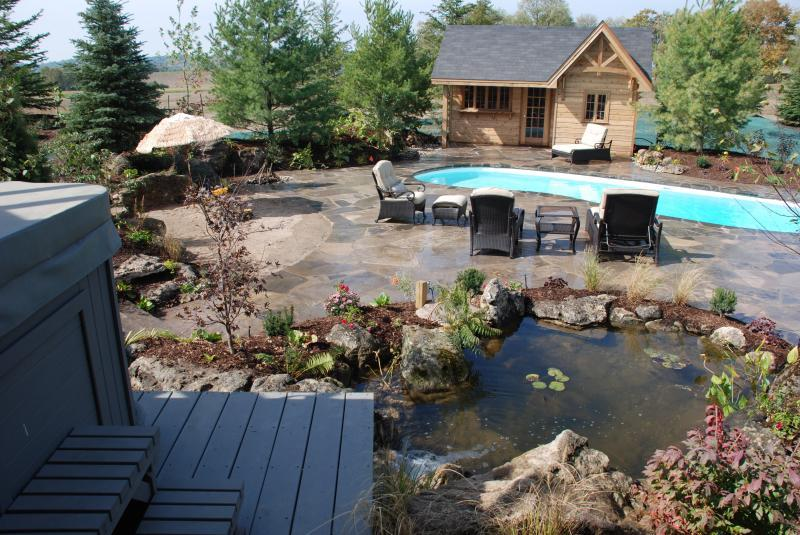 2007 - Residential Construction - $250,000 - $500,000 - After 1(goes with Before 1): Complete oasis. Hot tub, sand beach, cabana, pool, lily pond.