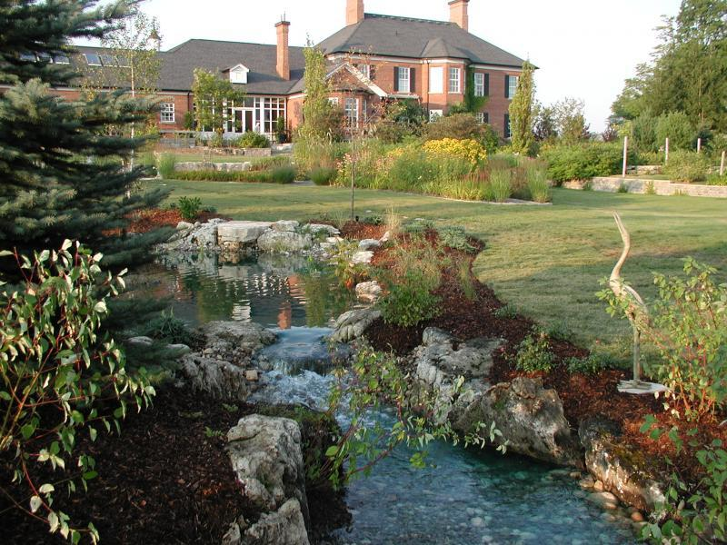 2007 - Water Features  - The water feature was located to hide utility areas will creating some focal point from the home.