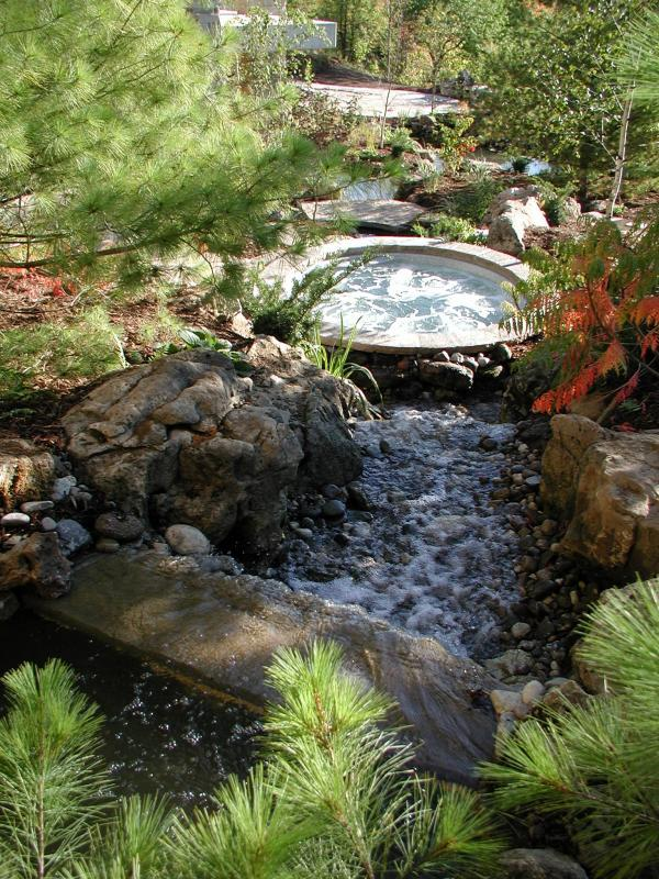 2007 - Residential Construction  - $100,000 - $250,000 - River engulfs a hot tub engineered to seat directly into the water!