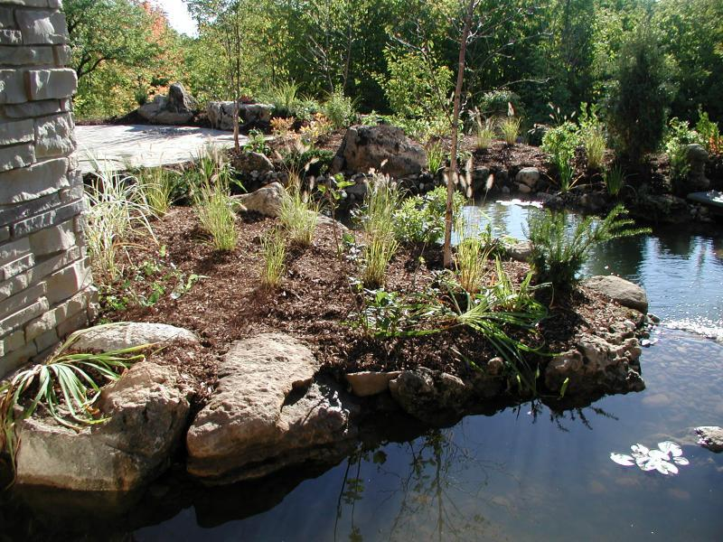 2007 - Water Features  - An island was created to 'hold' the pillar & has a stepping stone path over to it.