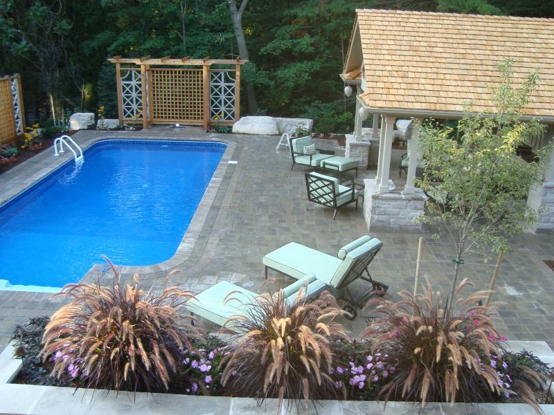 2009 - Residential Construction  - $100,000 - $250,000 - view from deck of  pool seating area and portico