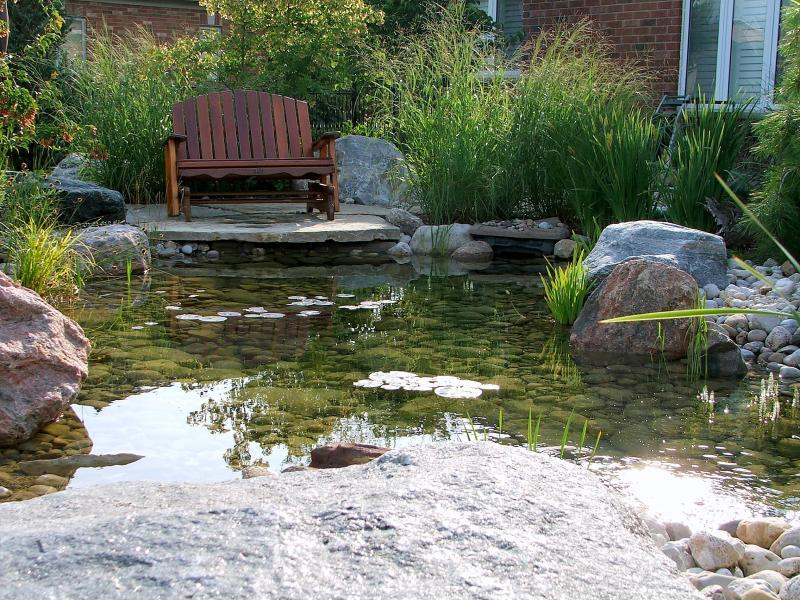 2010 - Residential Construction - $50,000 - $100,000 - 12 pond side patio surrounded by plantings