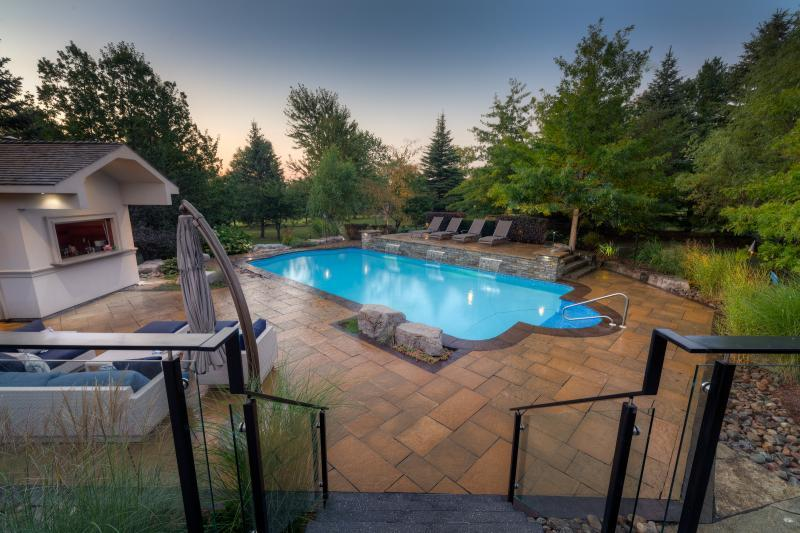 2015 - Residential Construction  - $100,000 - $250,000 - View of pool and waterfall from steps down from raised concrete deck