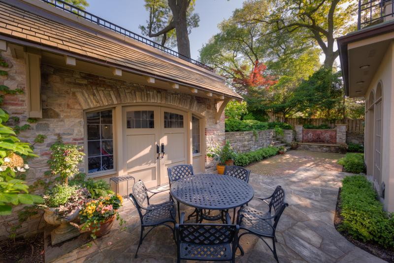 2016 - Residential Construction - $250,000 - $500,000 - The beauty of the stonework is enhanced and softened by the addition of boxwood borders, annual container plantings, and a lush garden on the upper level.
