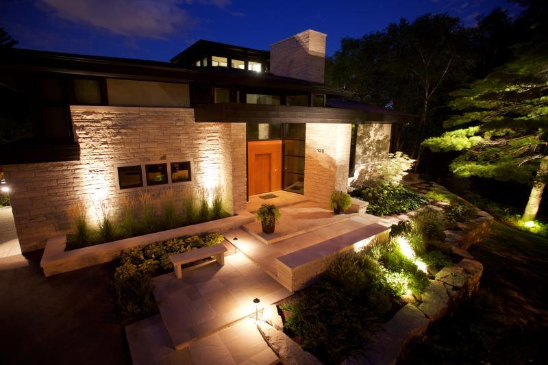 2016 - Landscape Lighting Design & Installation - $10,000 - $30,000 - front house view of path lighting and tree lights illumating the gardens, paths
