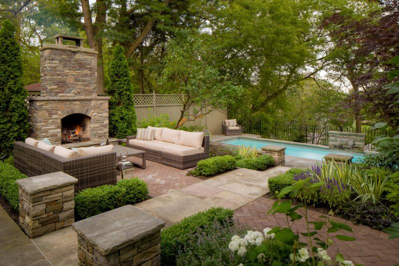2017 - Residential Construction - $250,000 - $500,000 - We continued the boxwood border and perennial infill planting theme established in the front yard.  We find that this type of planting provides a certain amount of formality, while allowing the interior mix of perennials to soften and relax the space.